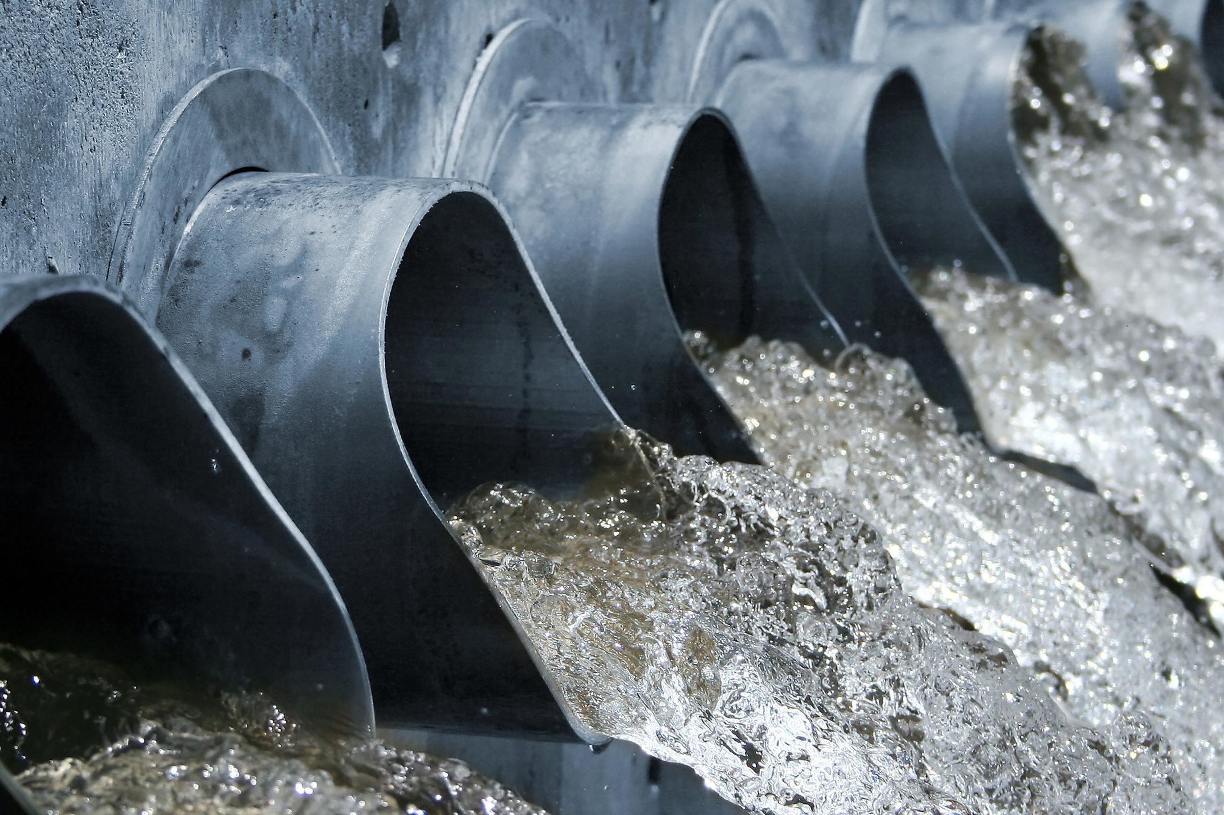 Water gushing out of steel spouts. Courtesy Getty Images.
