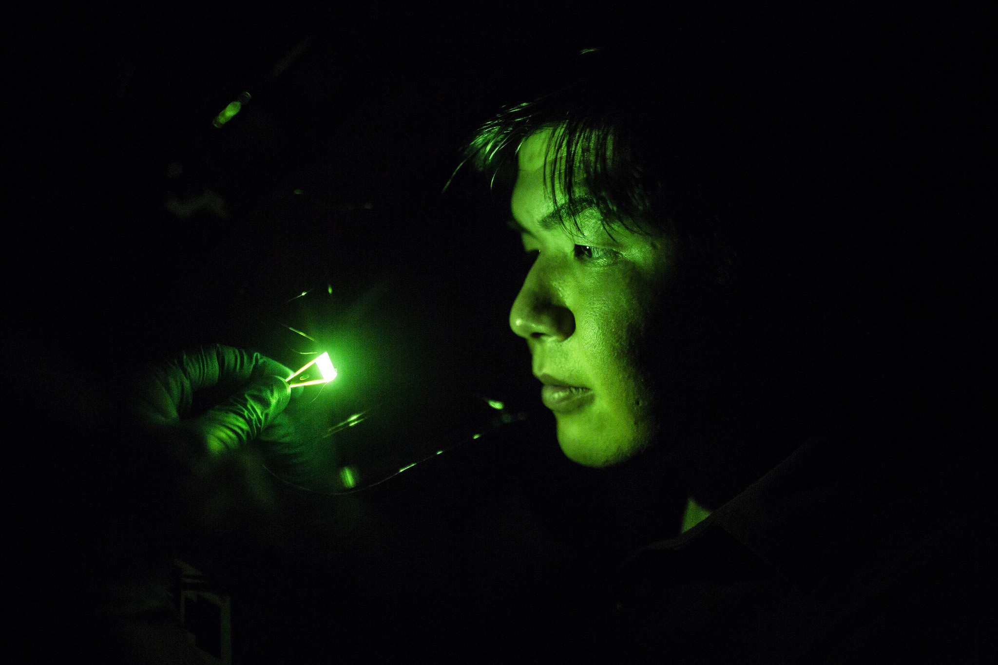 A photograph of an EECS student working with a pyramidal LED.