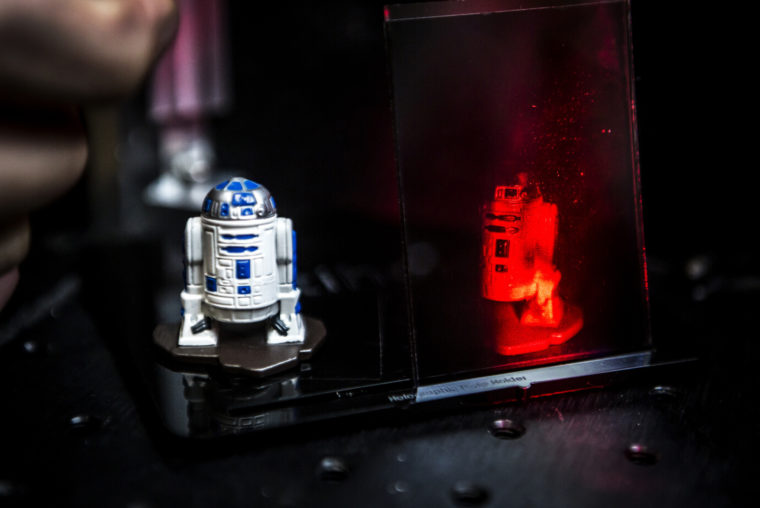 A photograph of a hologram of R2D2.