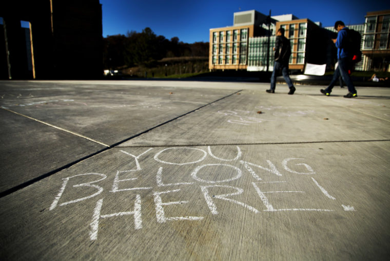A photograph of the Eda U. Gerstacker Grove chalked with positive affirmations.
