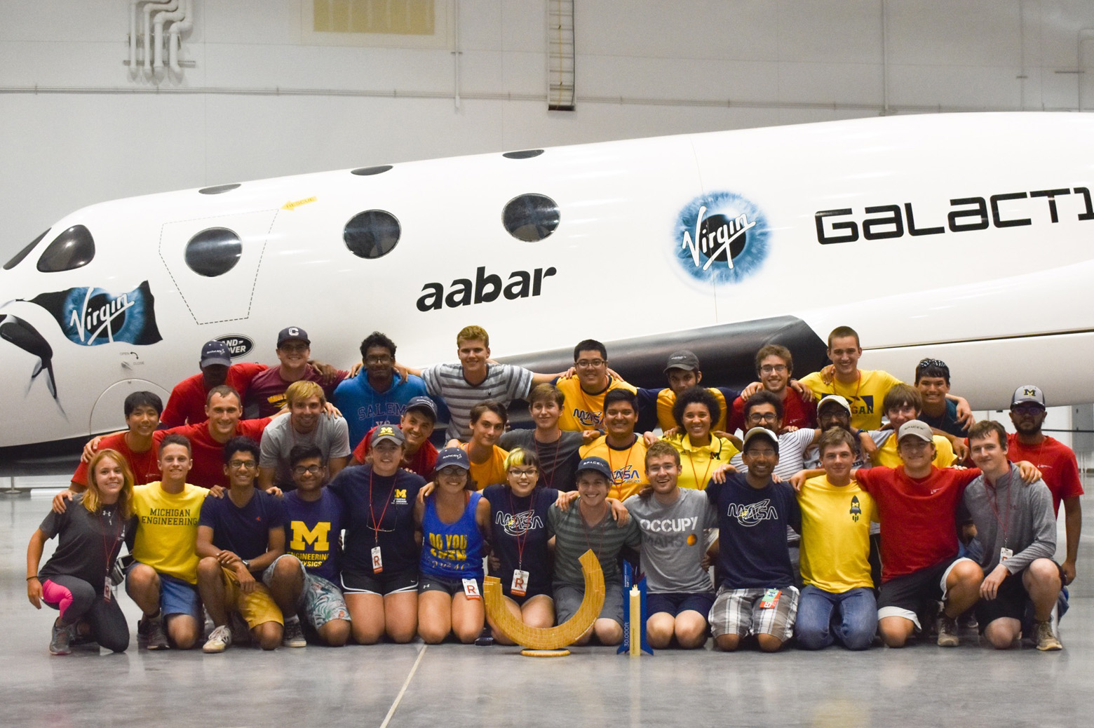 MASA team photo by a rocket