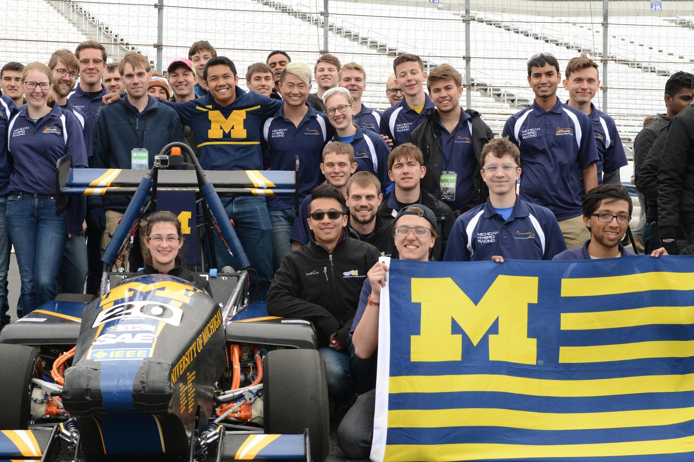 MHybrid team posing with car