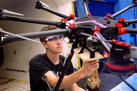 Student works with a drone