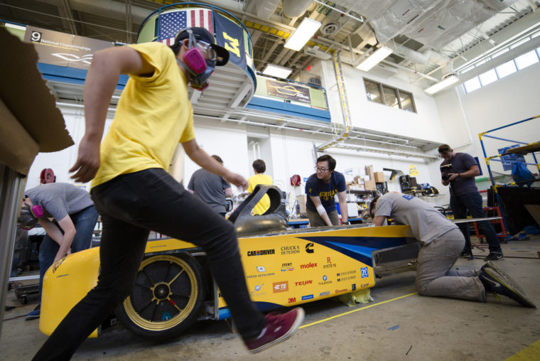 A photograph of students working on the solar car.