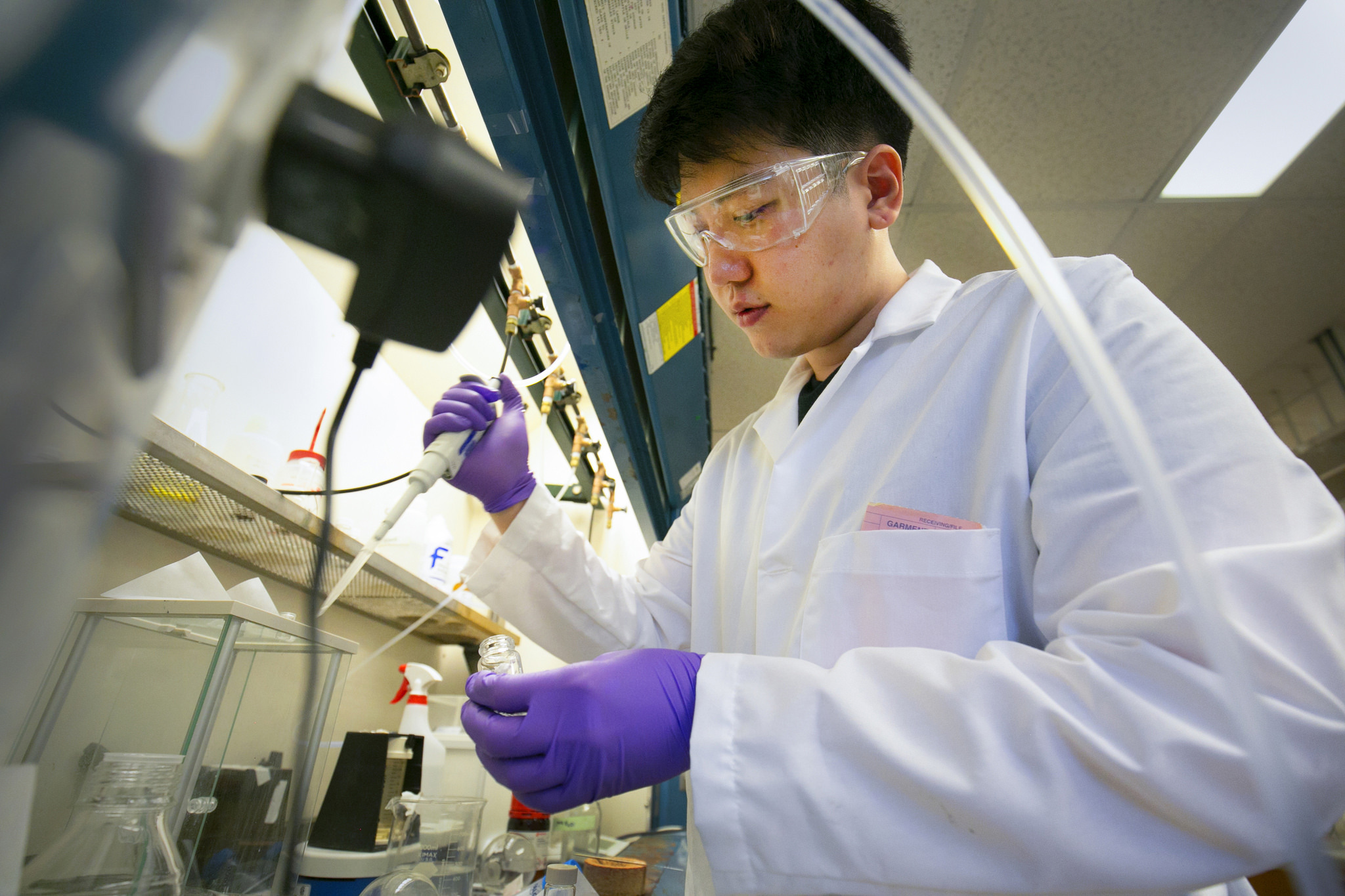 A photograph a researcher working in lab.