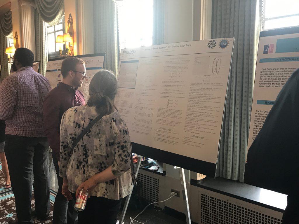 Undergraduate Joseph Sauder (University of Puerto Rico) explains how research to Karen Smith (University of Michigan)