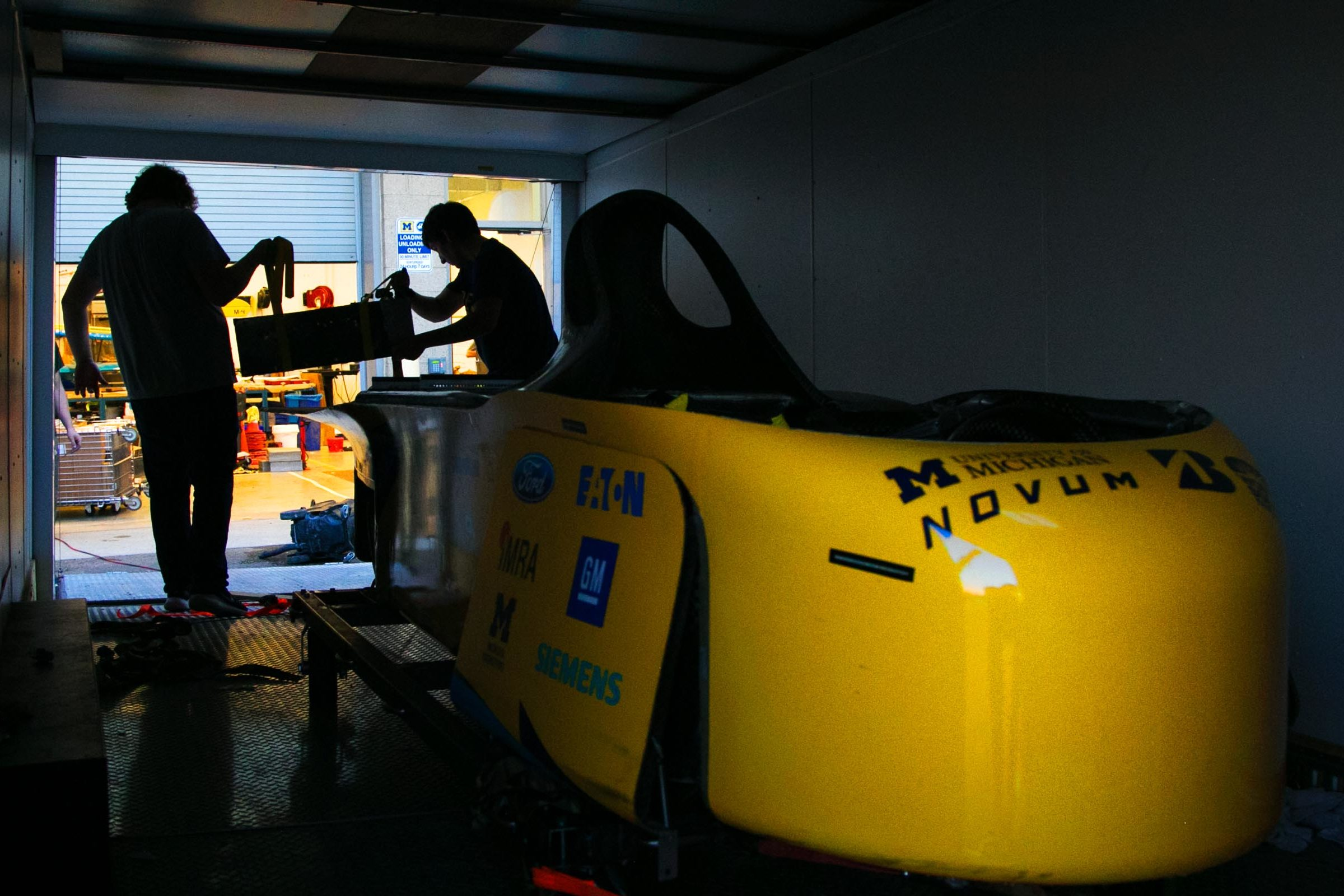 Solar car inside shipping container.