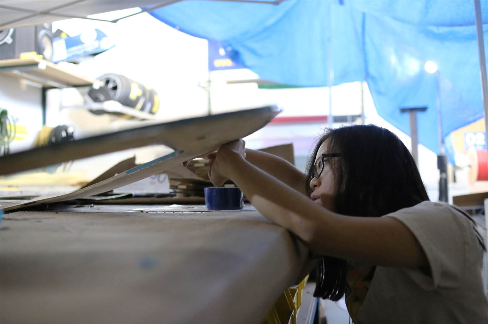 Janice Lau, Race Operations Engineer works on Novum's carbon fiber shell.