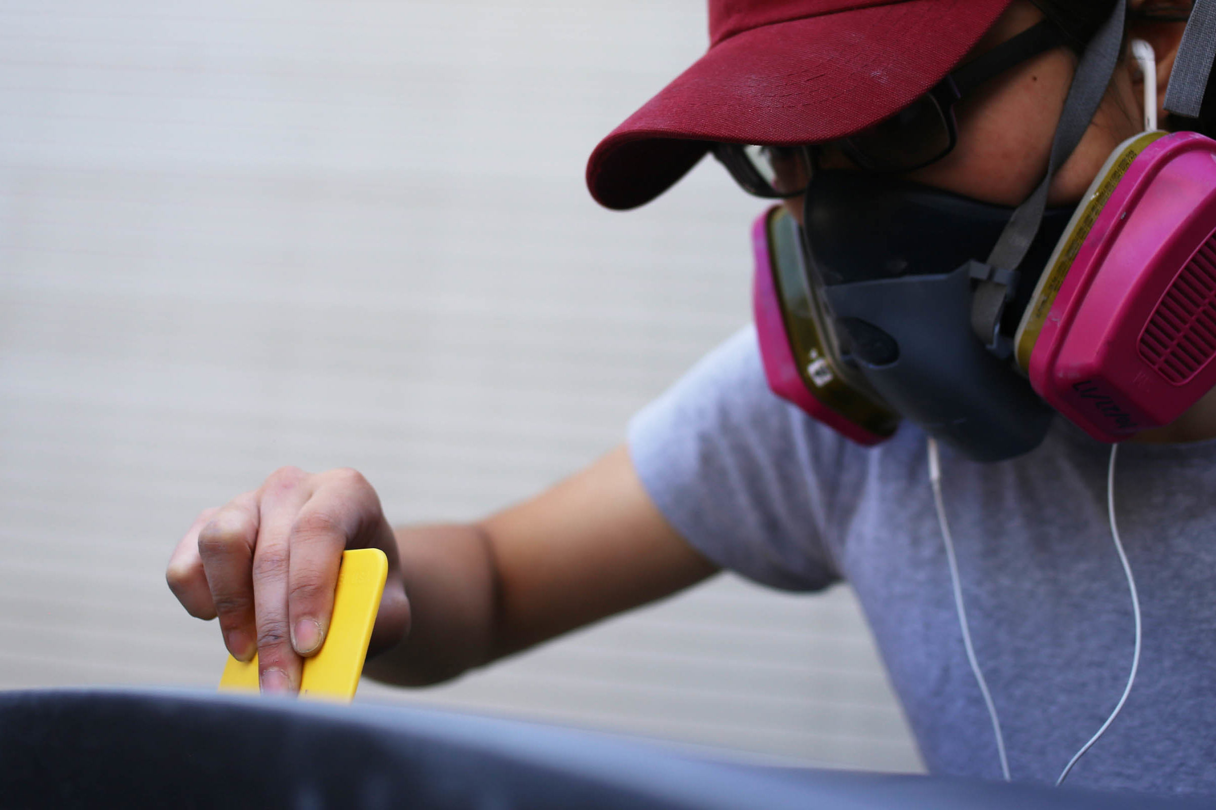 Janice Lau, Race Operations Engineer works on Novum's carbon fiber body.
