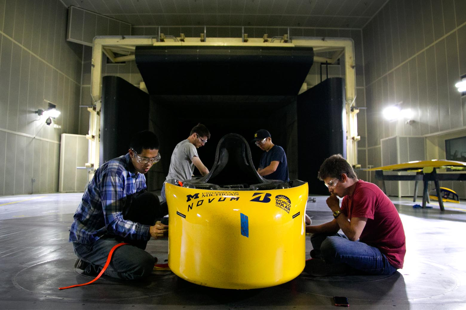 Jiahong Min, Andrew Dickinson, Chae Woo Lim and Clayton Dailey prepare Novum for wind tunnel testing.