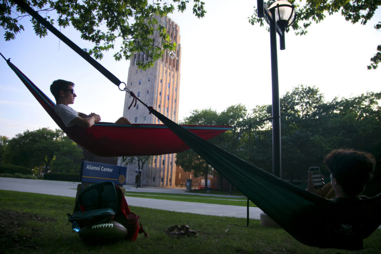 A photograph of students hanging in hammocks at the Ingalls Mall.