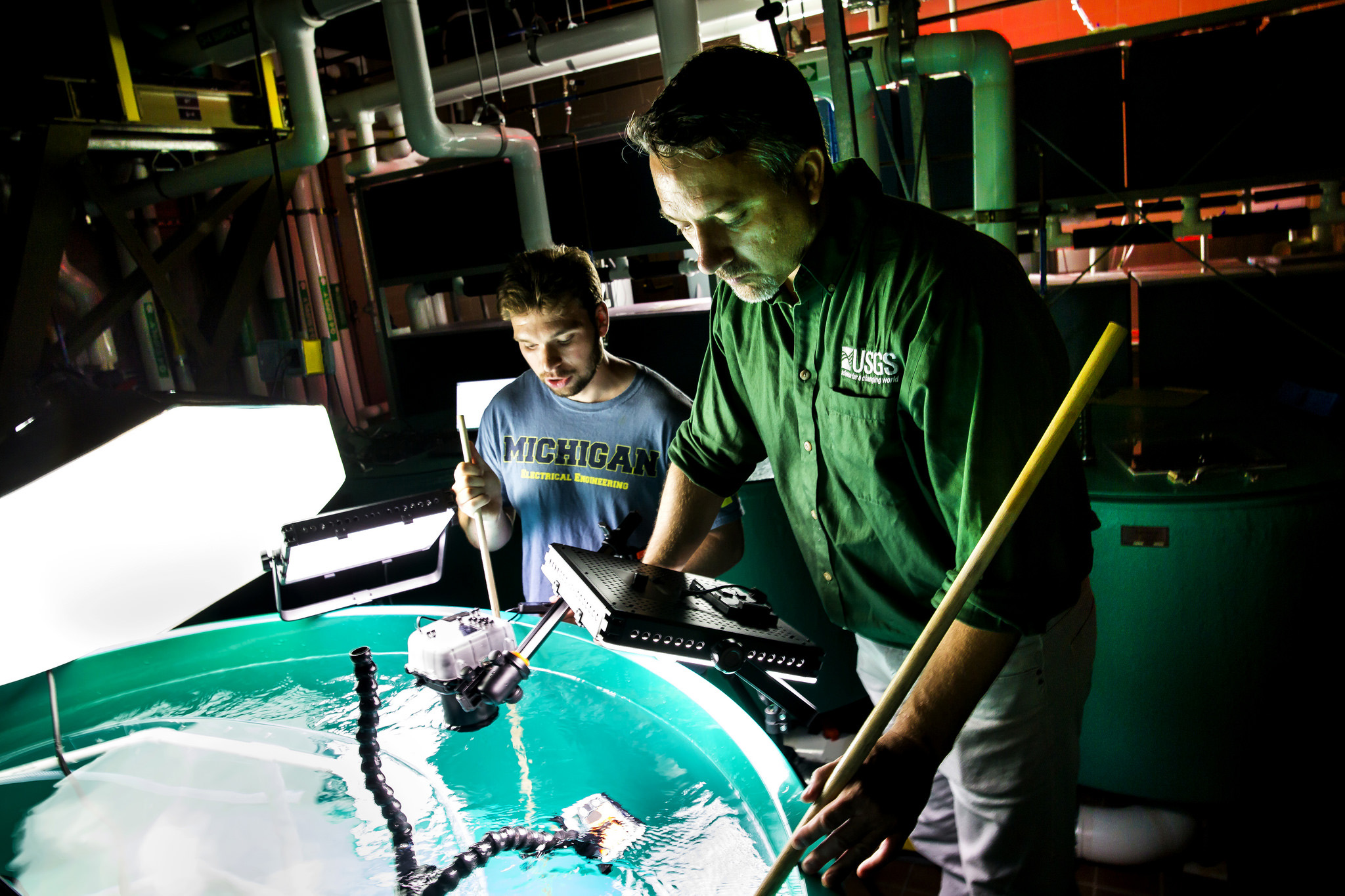 A photograph of researchers working on an underwater camera.
