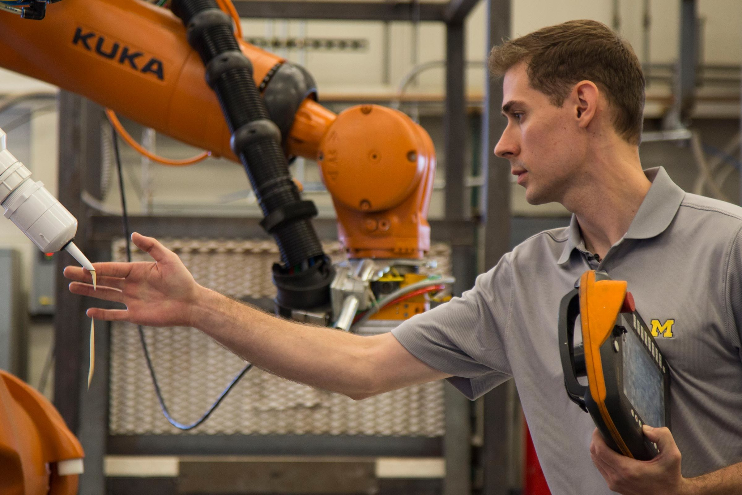 Kurt Lundeen tests out construction robot
