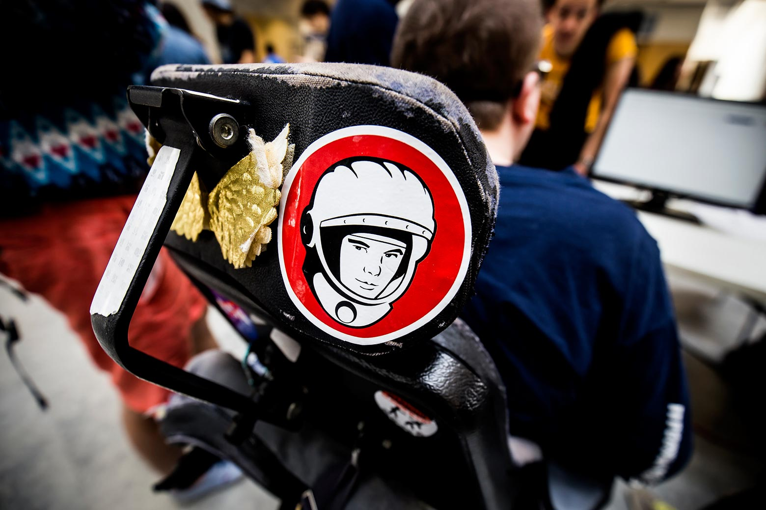 An astronaut sticker adorns the back of a disabled student's wheelchair