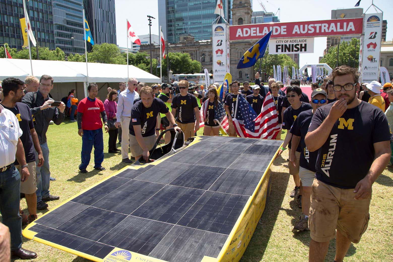 The U-M Solar Car Team crosses the finish line in fourth place in Adelaide at the 2015 Bridgestone World Solar Challenge.
