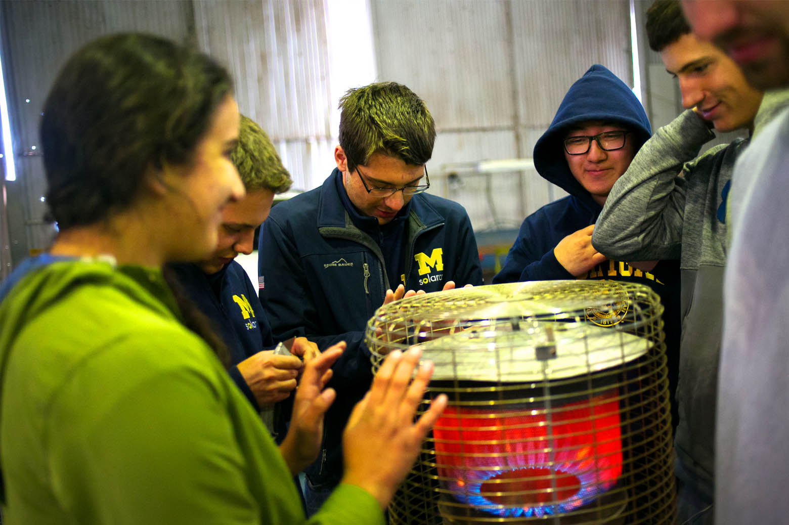 Team members gather around the space heater, graciously bequeathed by Parafield Airport