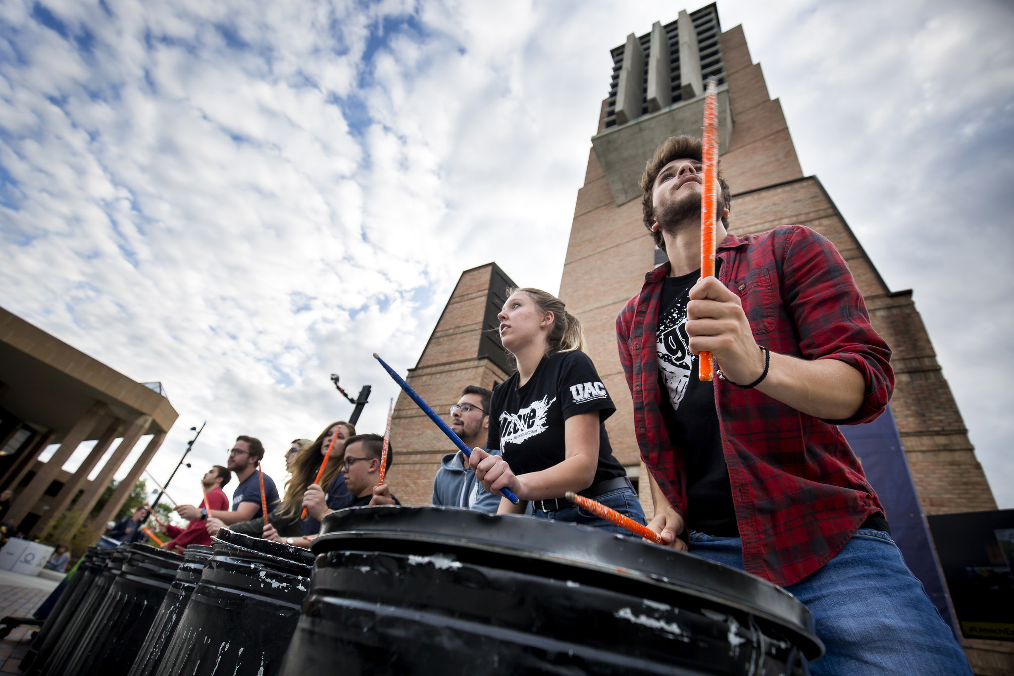 A photograph of a student performance group drumming.