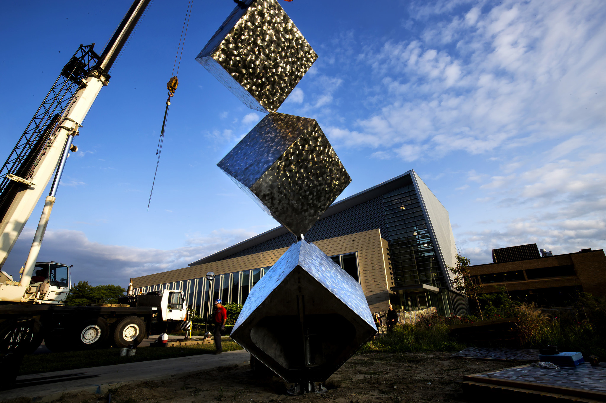 A photograph of an art sculpture in front of the GG Brown Building.