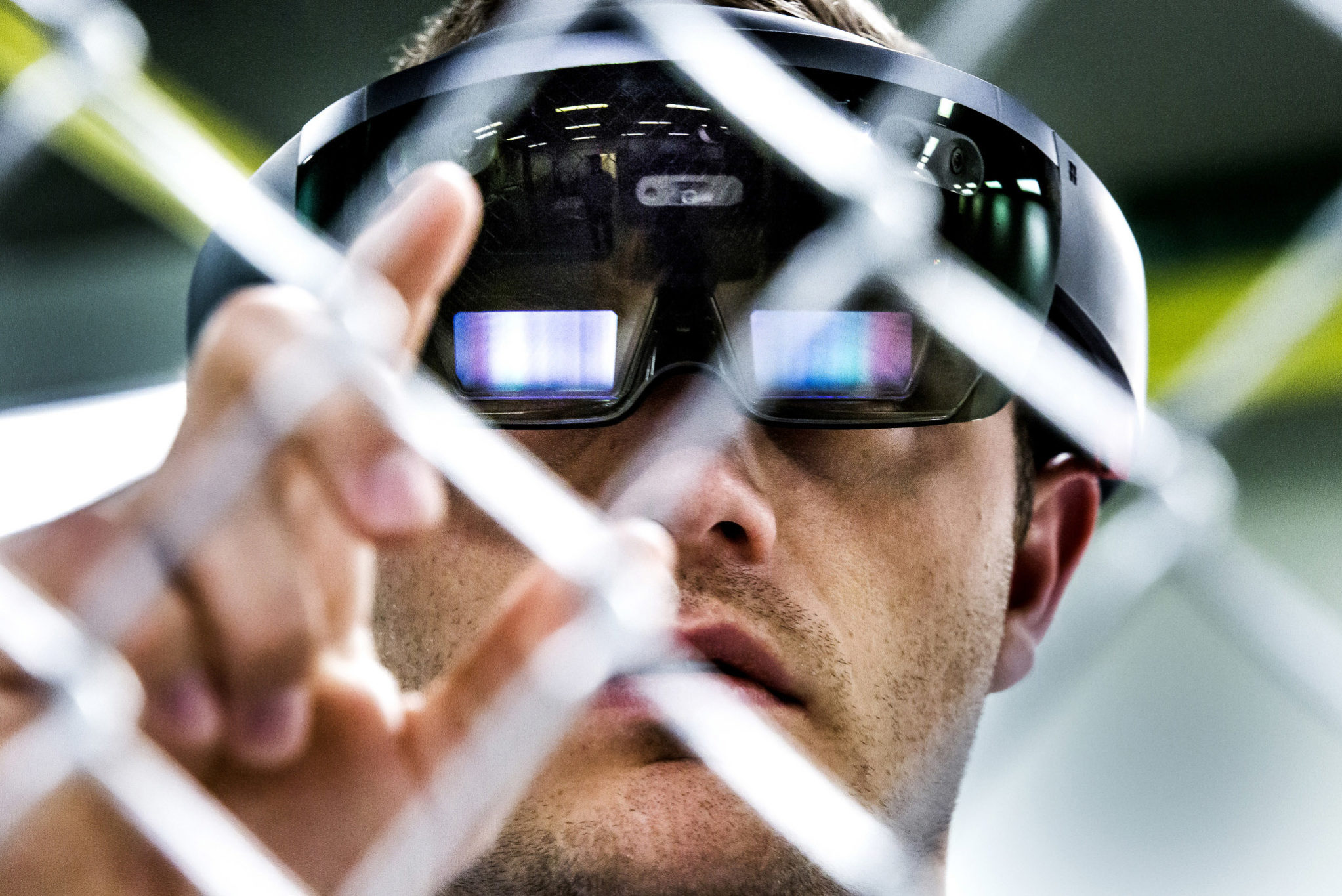 A photograph of a researcher using an augmented reality headset.
