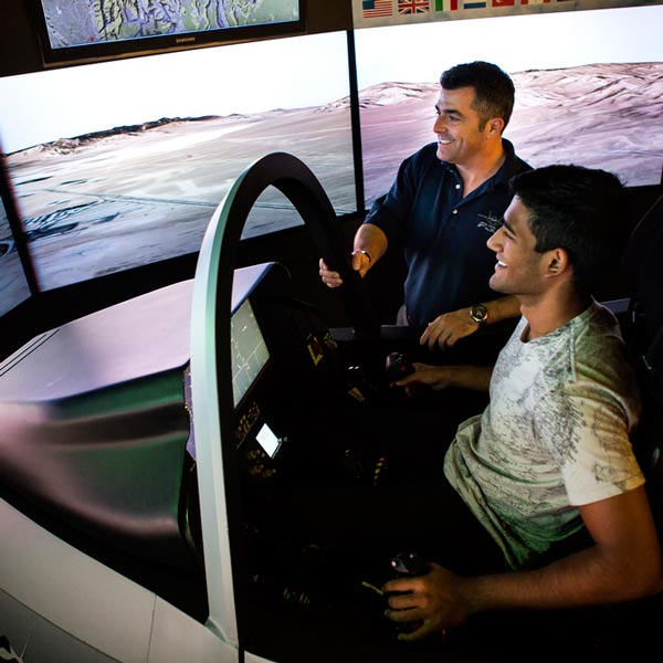 Two scientists work with a simulator