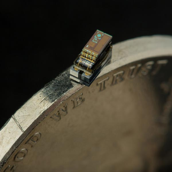 Smallest computer chip sits on the rim of a coin