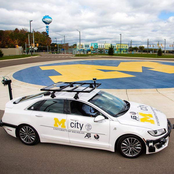 An autonomous vehicle parked in Mcity's roundabout