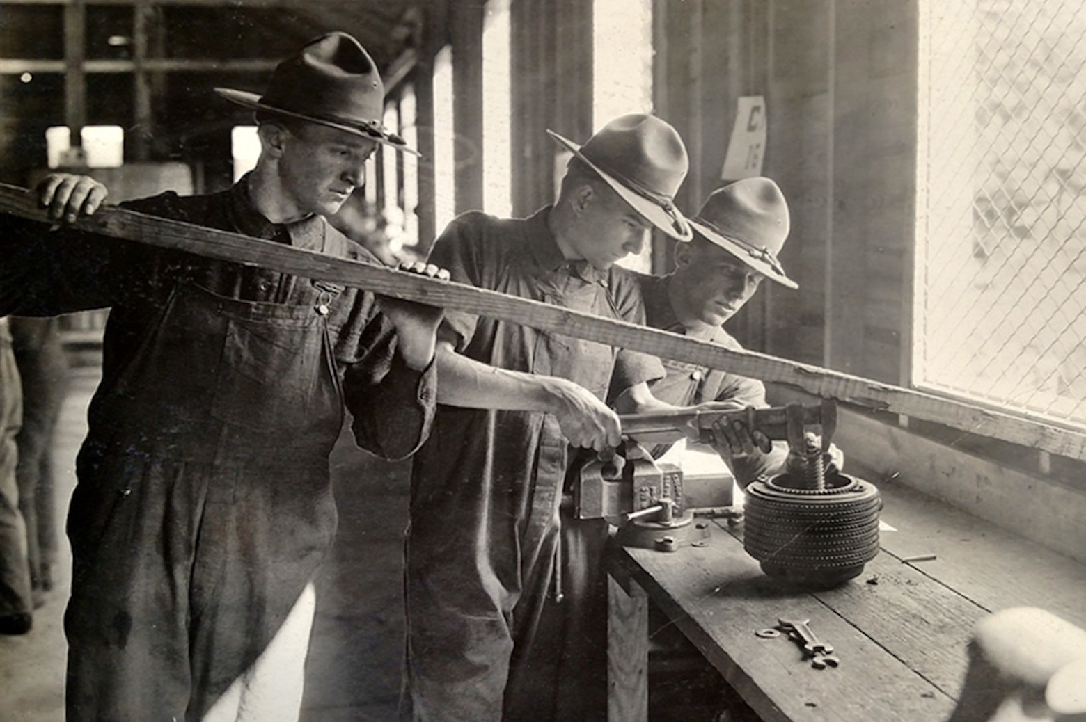 3 men working in workshop