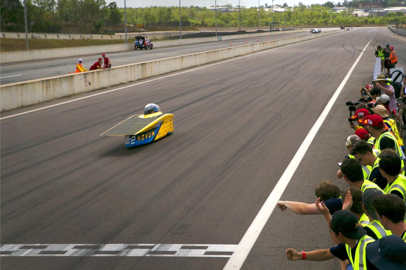 Novum completes the hot lap as the team cheers on the sidelines.