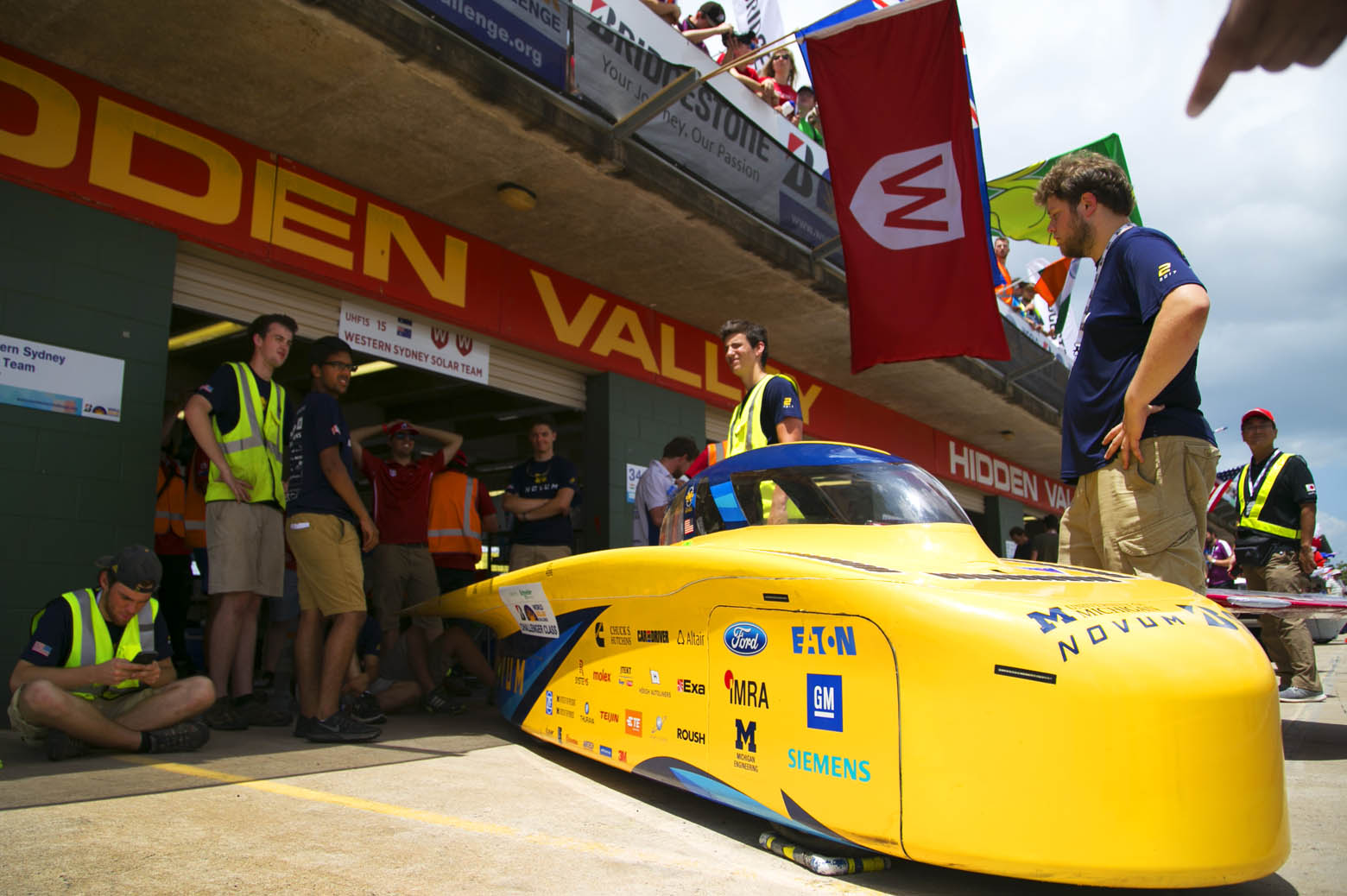 Novum leaves the team's garage and onto the pit row to run the hot lap.