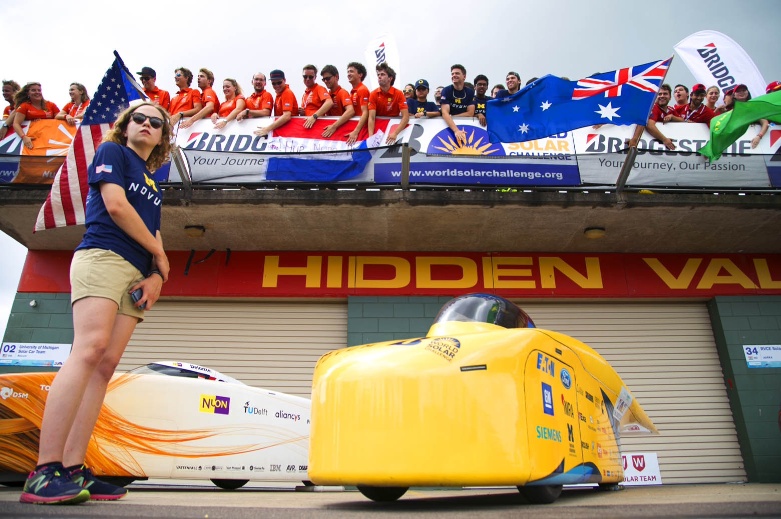 Sarah Zoellick guards Novum during the Bridgestone World Solar Challenge photo-op.