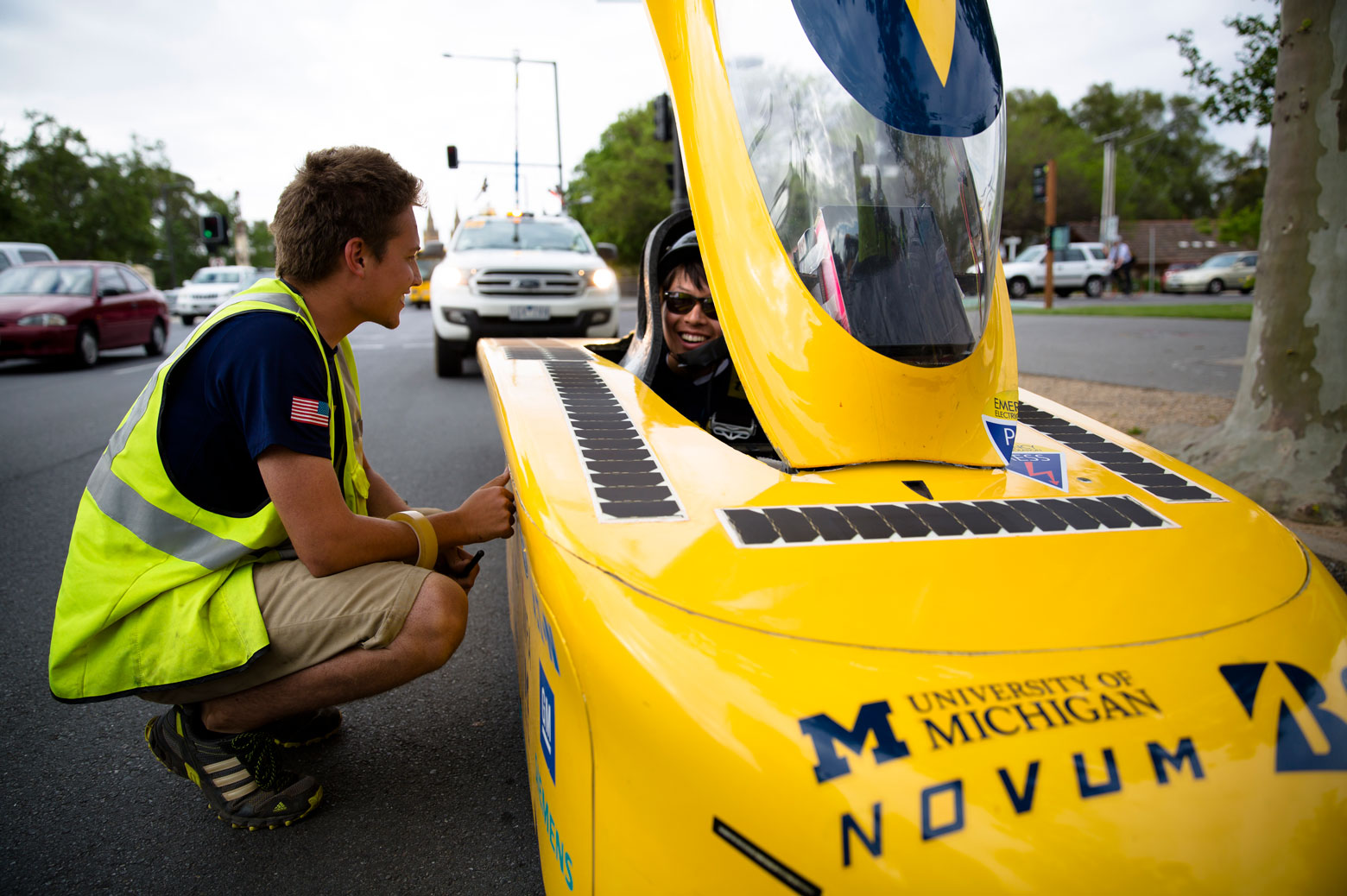 Student congratulates driver in solar car