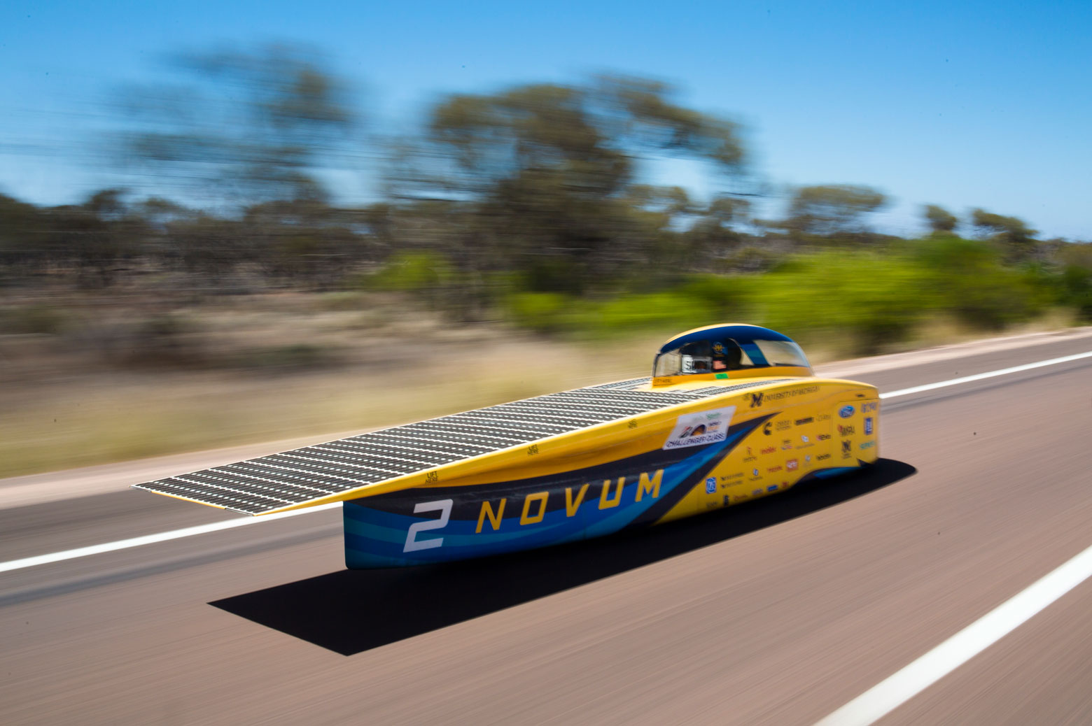 Solar car races down road in Australia