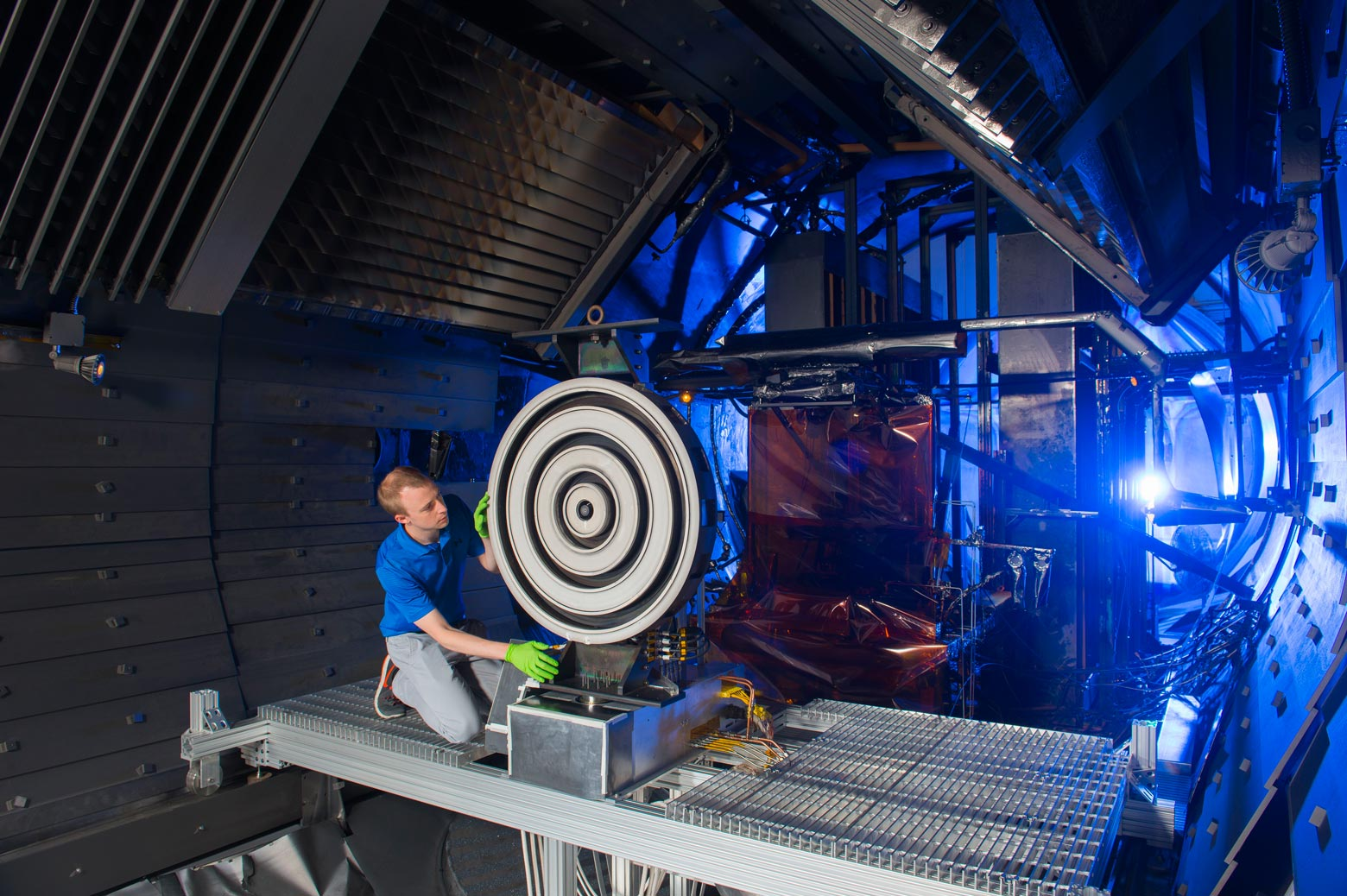 Researcher makes adjustments on an X3 thruster