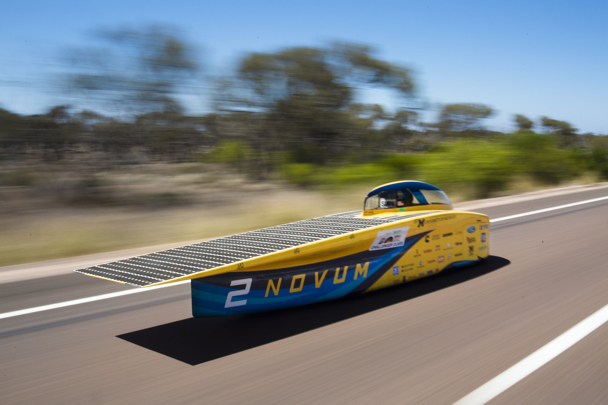 A photograph of the solar car driving.