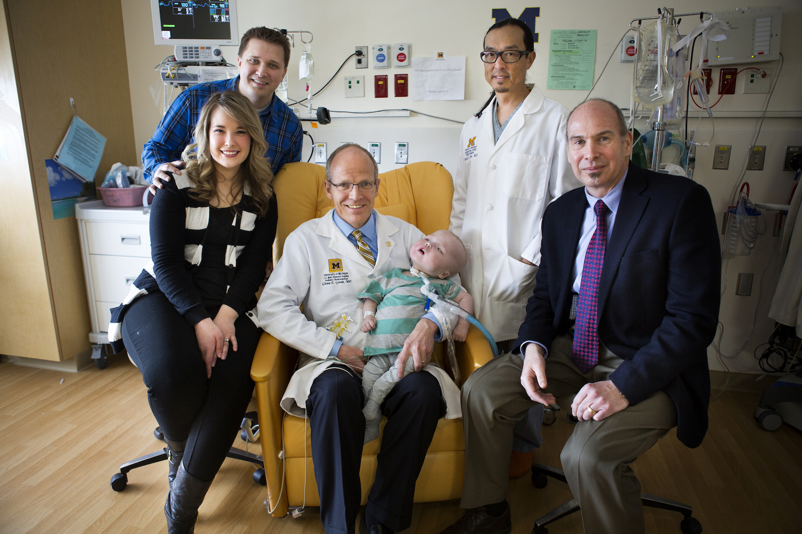 The Petrson family poses with Doctors who saved Garrett Peterson's life with 3-D splint technology at Mott's Children Hospital in Ann Arbor, MI on March 4, 2014.