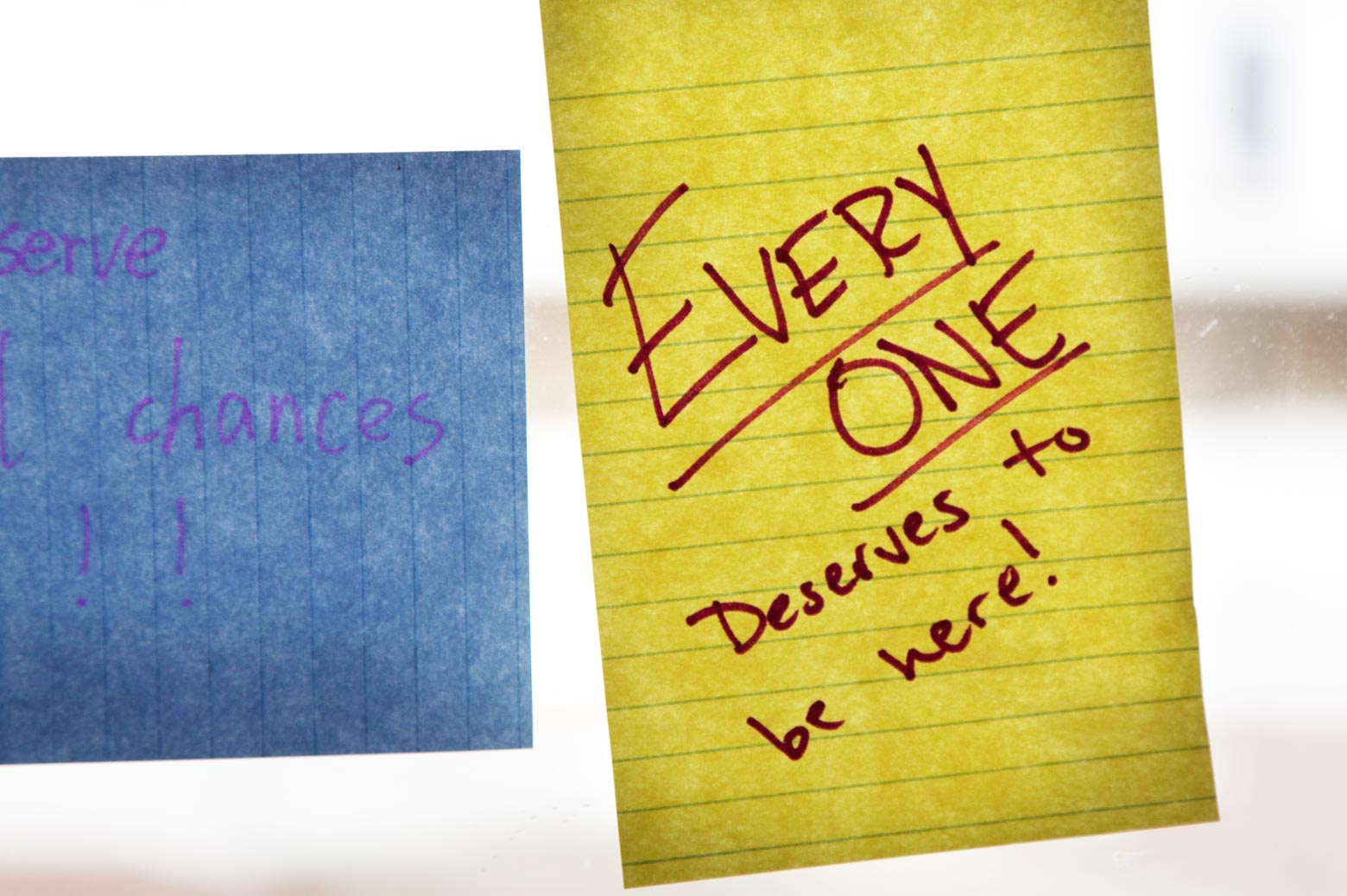 """Post it note reads """"everyone deserves to be here"""""""