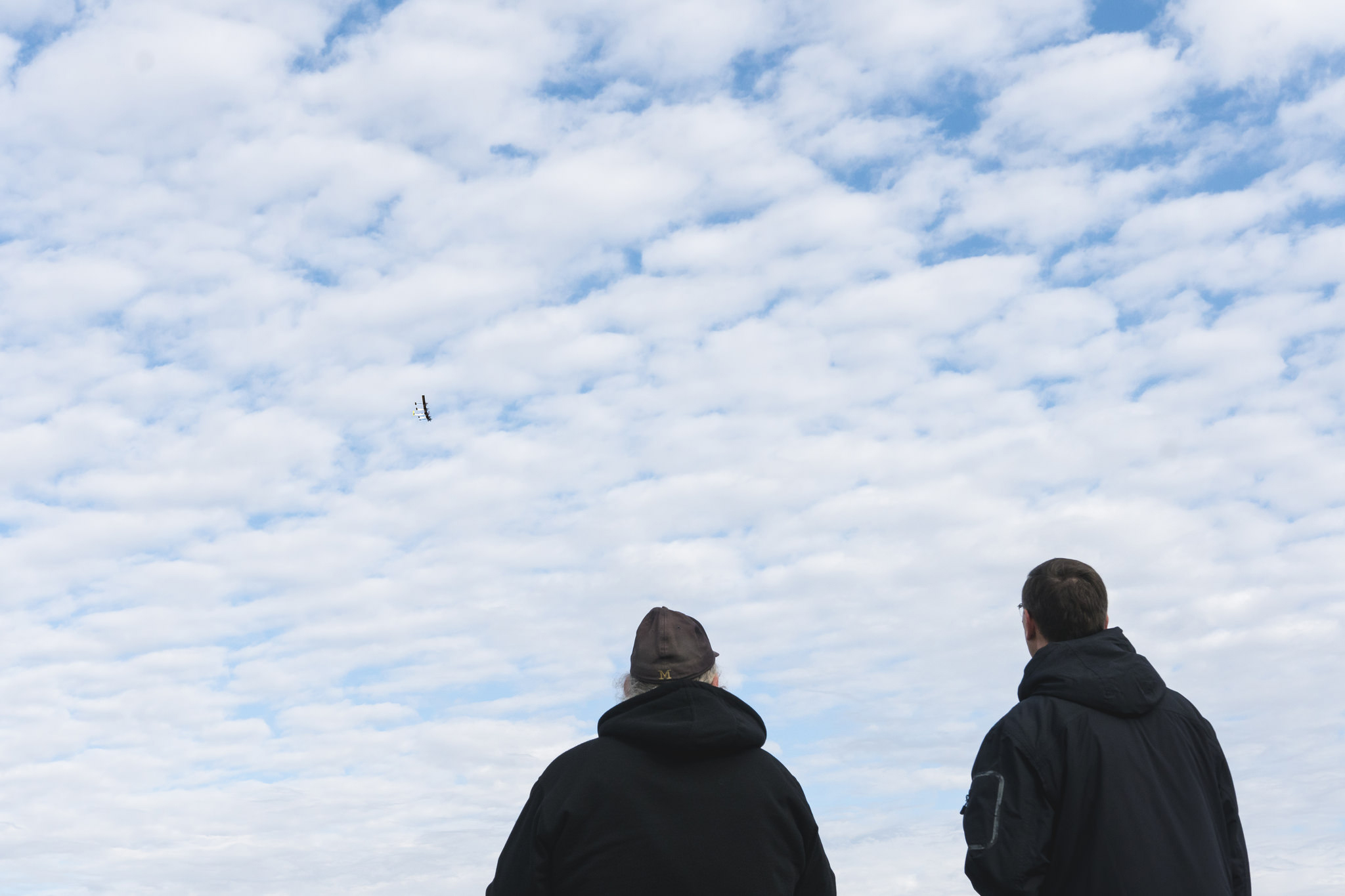 A photograph of researchers watching the X-HALE aircraft fly.
