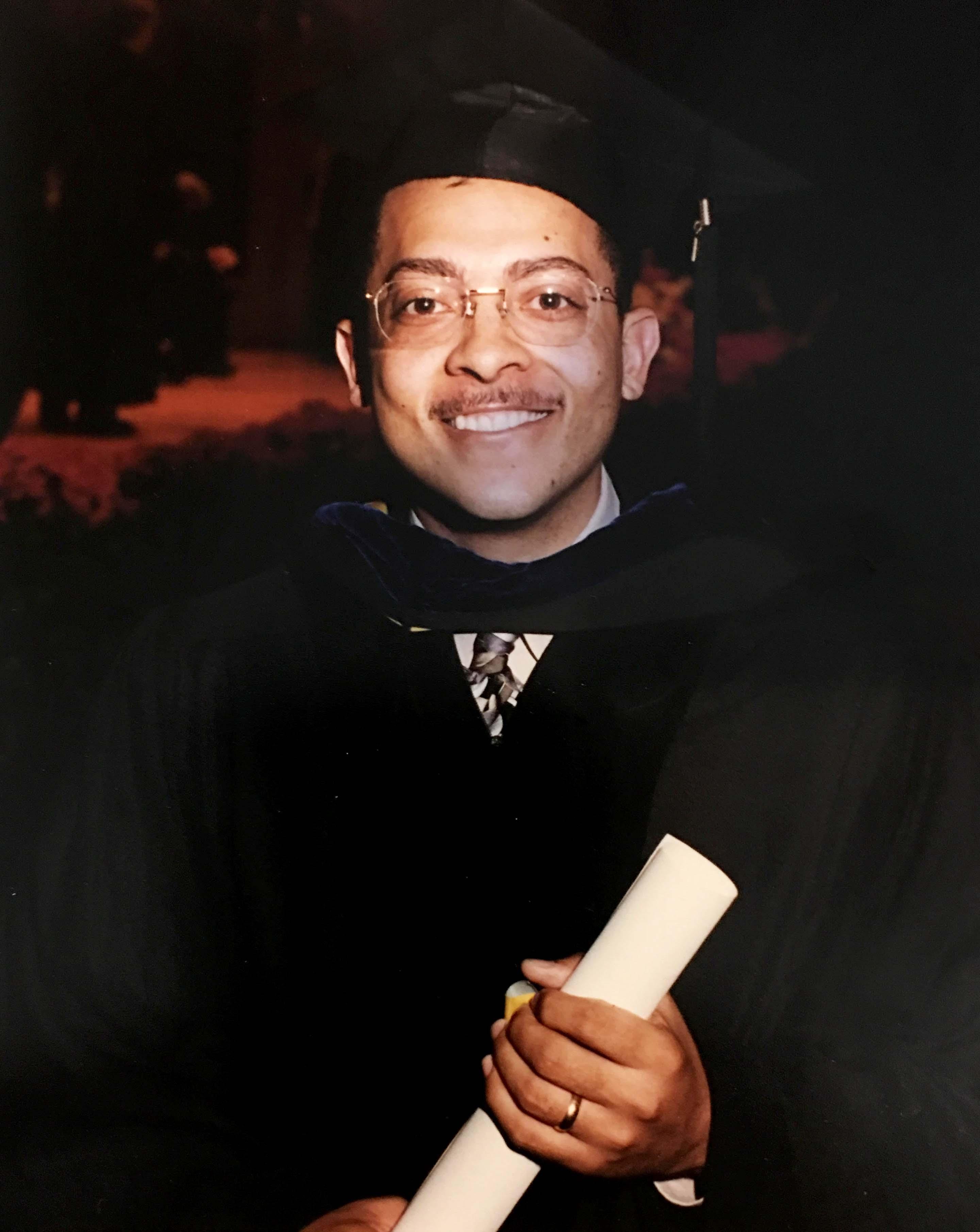 Isaac Porche holding diploma