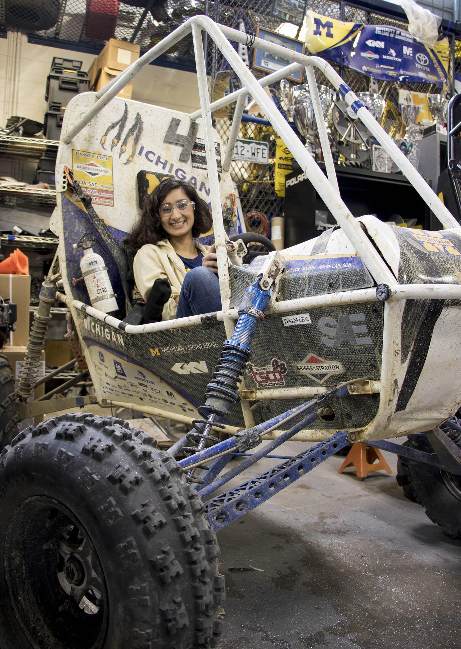 Shivani Shah sits in Baja car