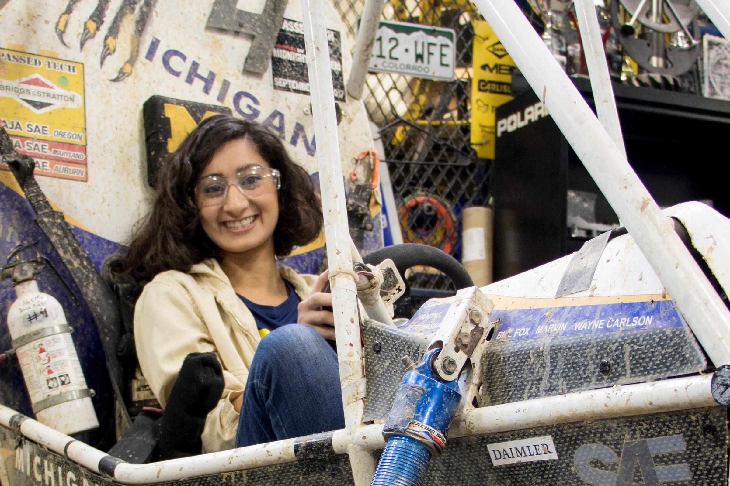 Shivani Shah sits in Baja vehicle