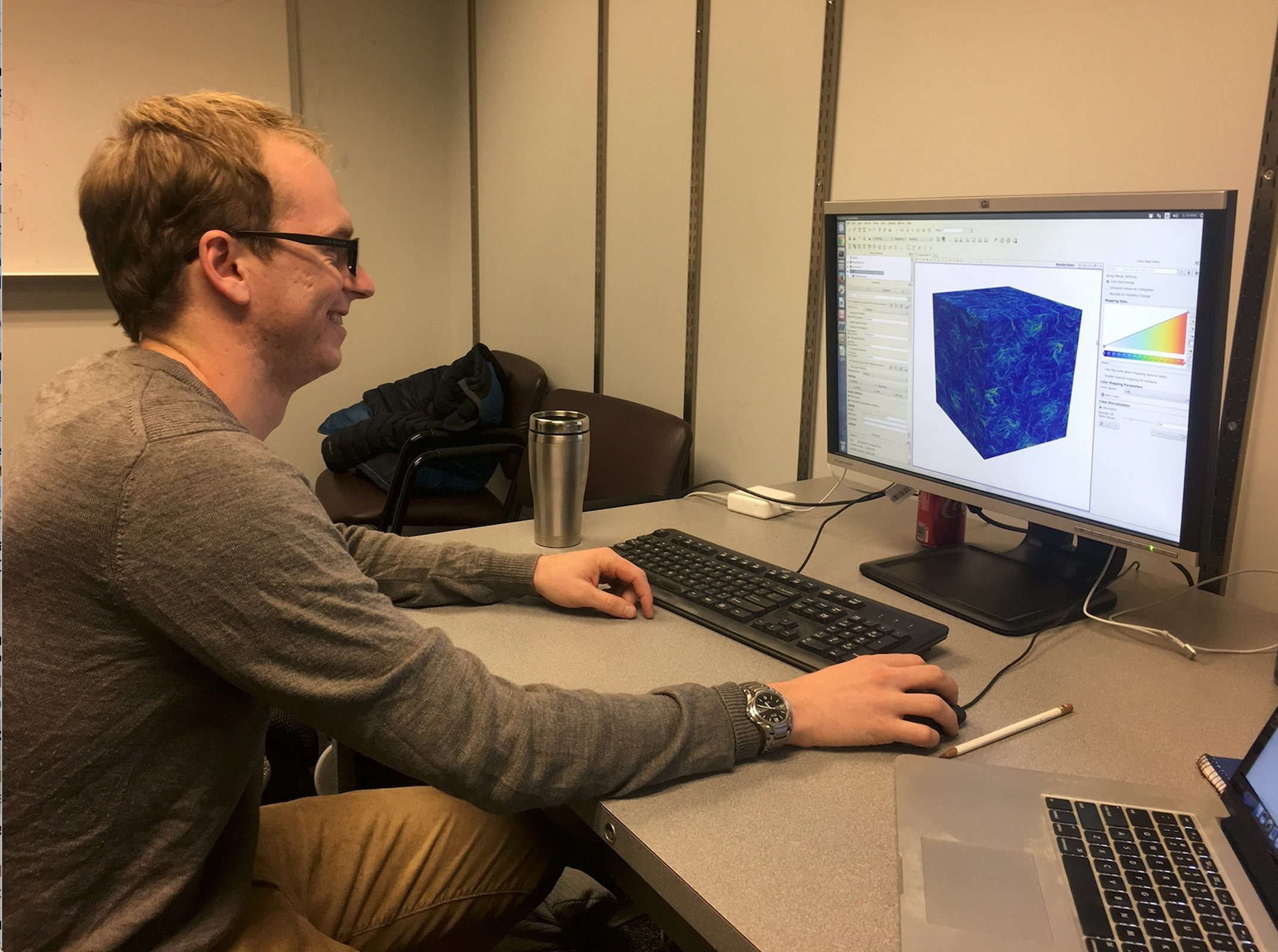 Ph.D. student Eric Parish working at a computer