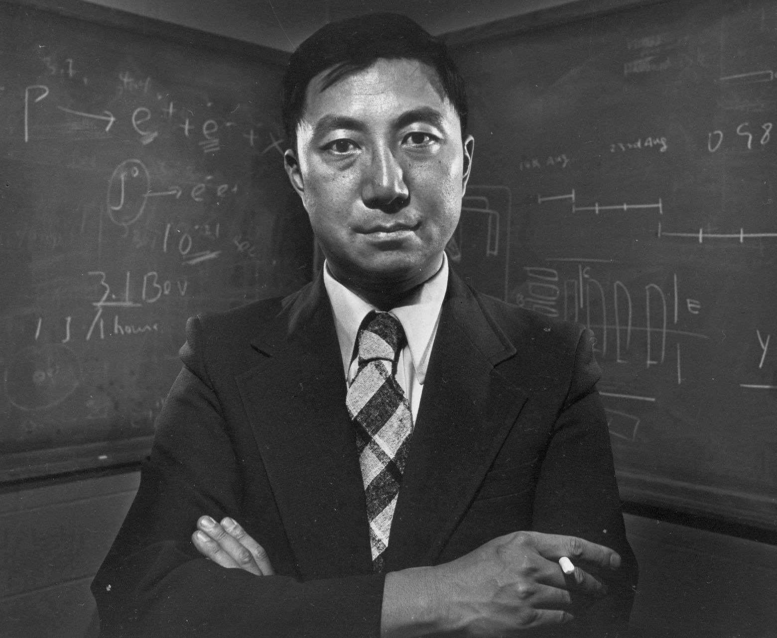 Samuel Chao Chung Ting is shown at Massachusetts Institute of Technology on Nov. 1, 1976. Ting, a longtime MIT professor, was co-winner of the Nobel Prize for physics in that year. (Photo: AP Photo. Previous image: Image of matter distribution in the universe from the Millennium Simulation Project, Max Planck Institute for Astrophysics.)