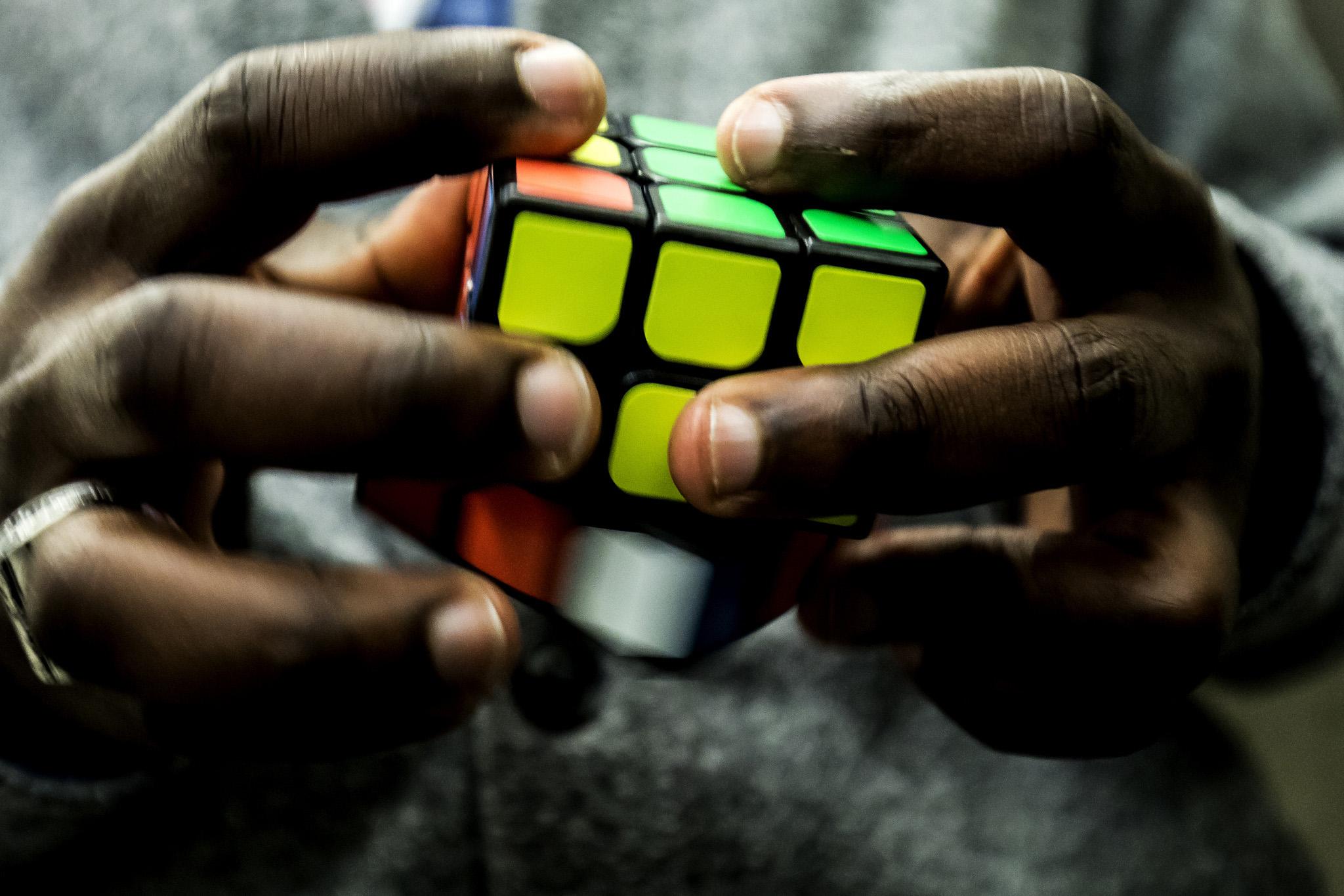 A prospective graduate student solving a rubik's cube.