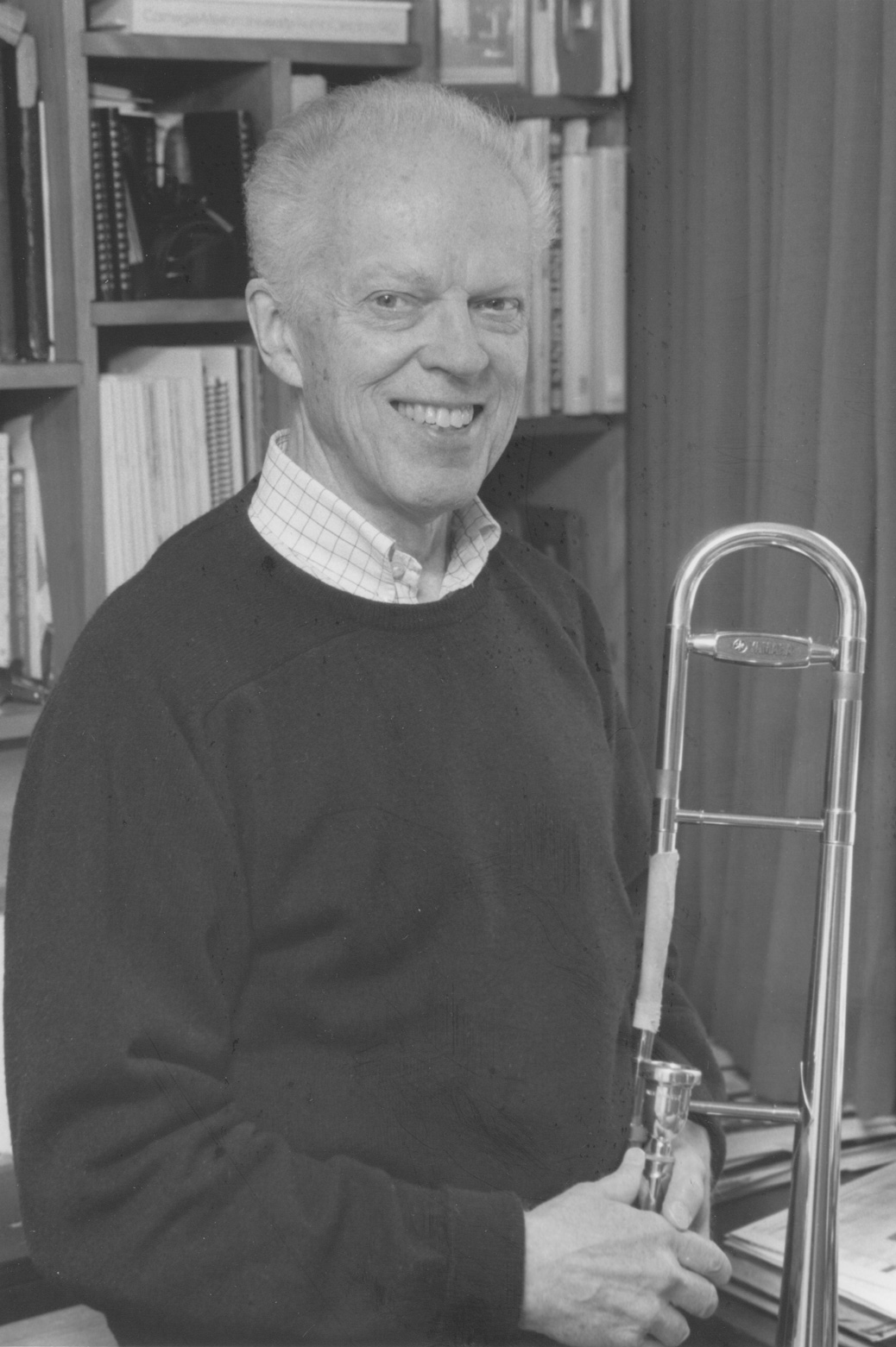 Professor Emeritus Richard Wilson with a trombone