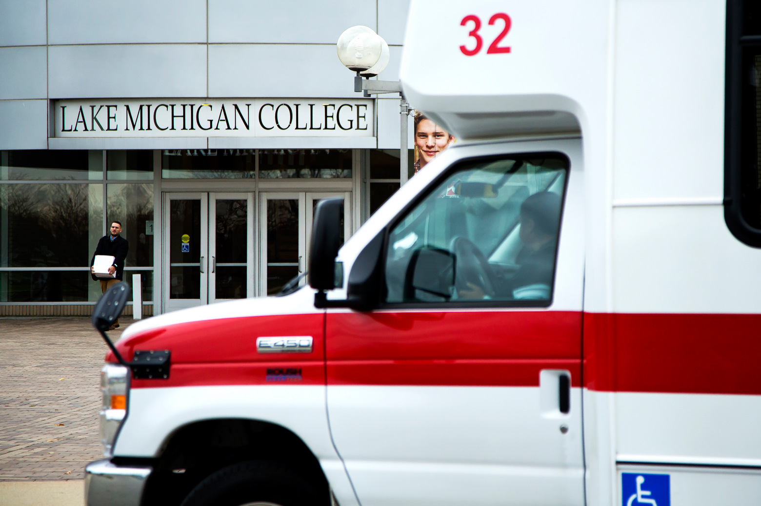 An ambulance waits outside the doors of a building