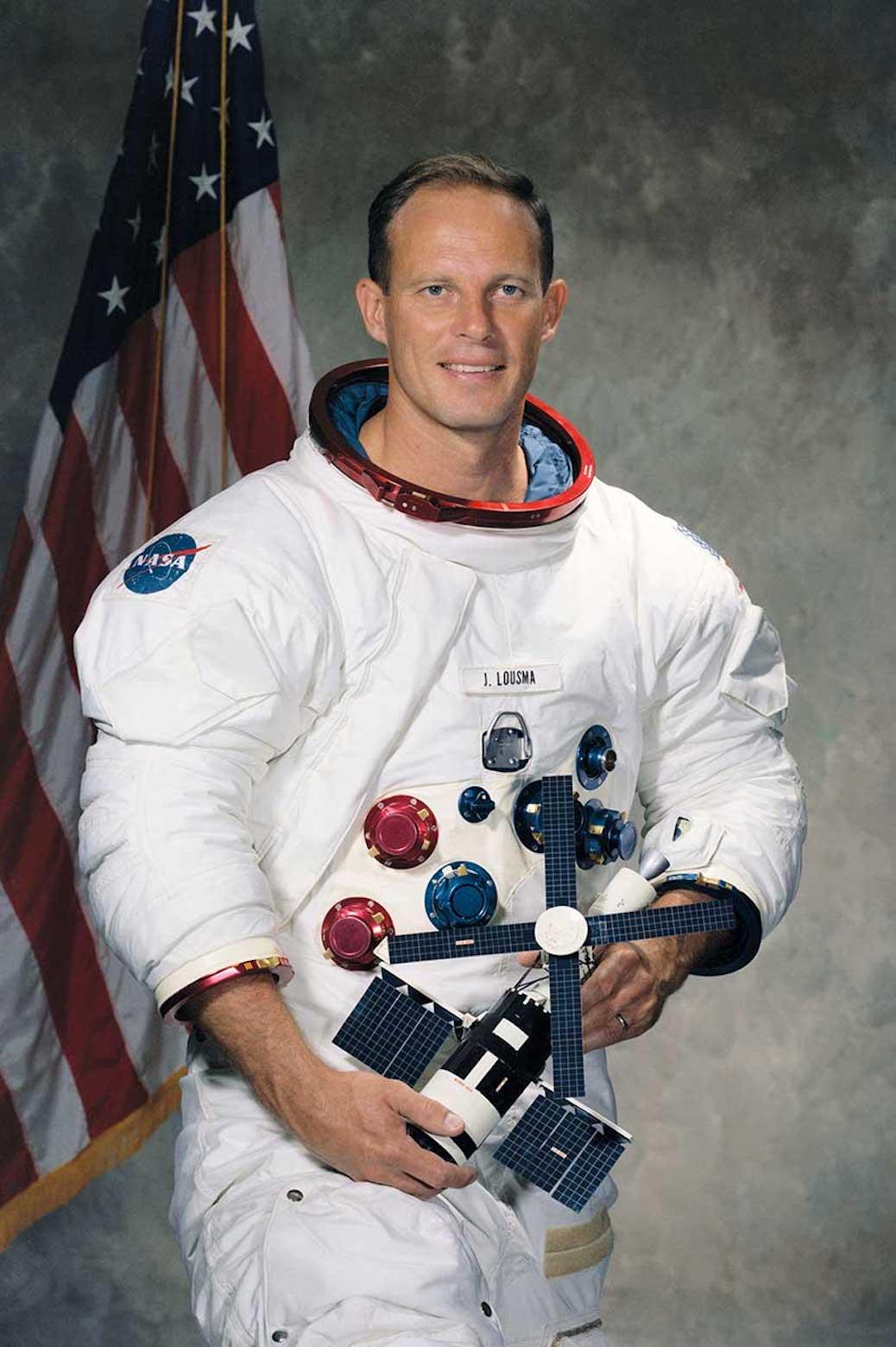 Portrait of Jack Lousma in his astronaut gear