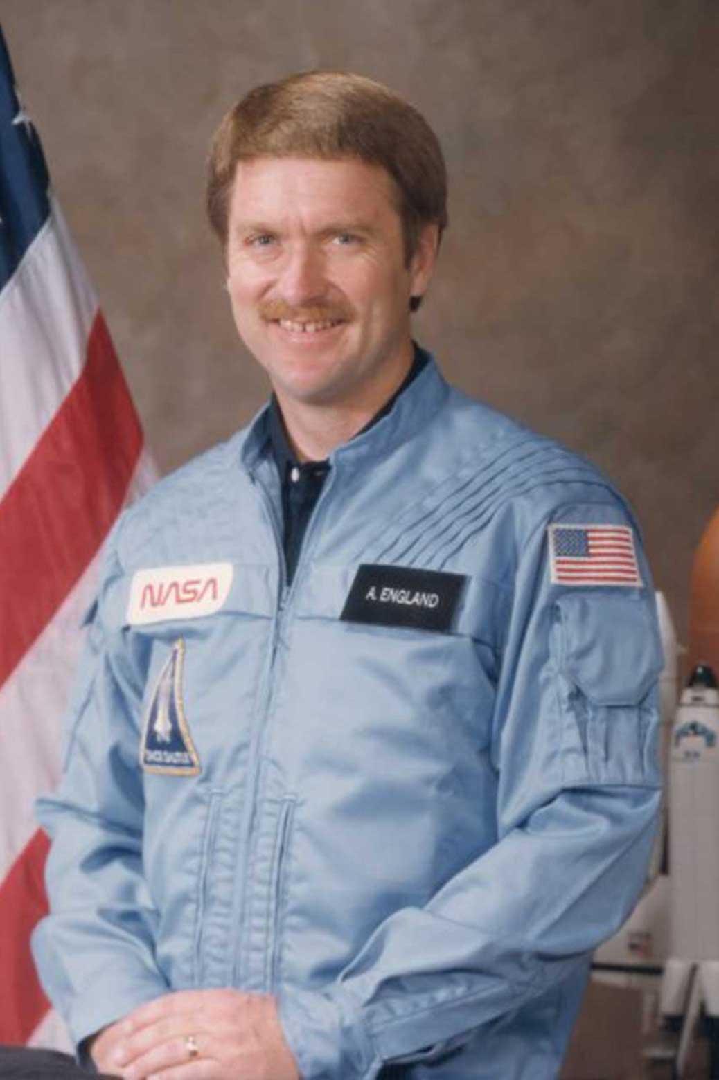 Portrait of Tony England in NASA uniform