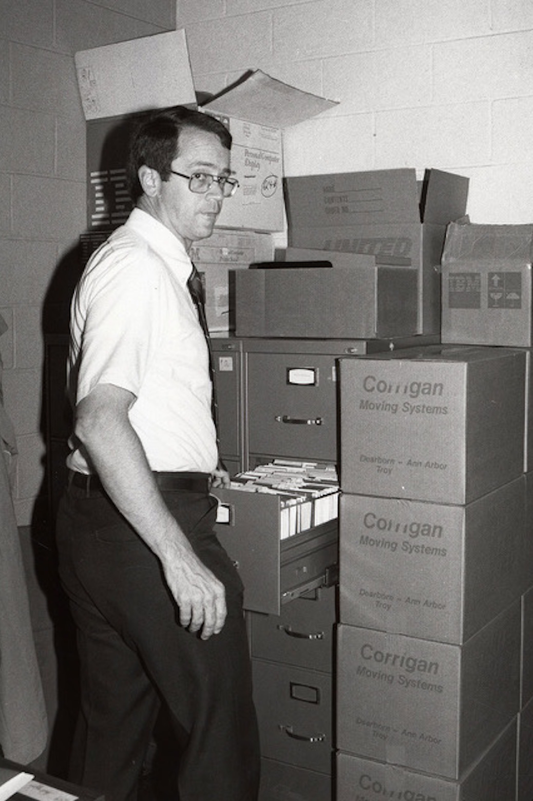 Charles Vest opening up a file cabinet