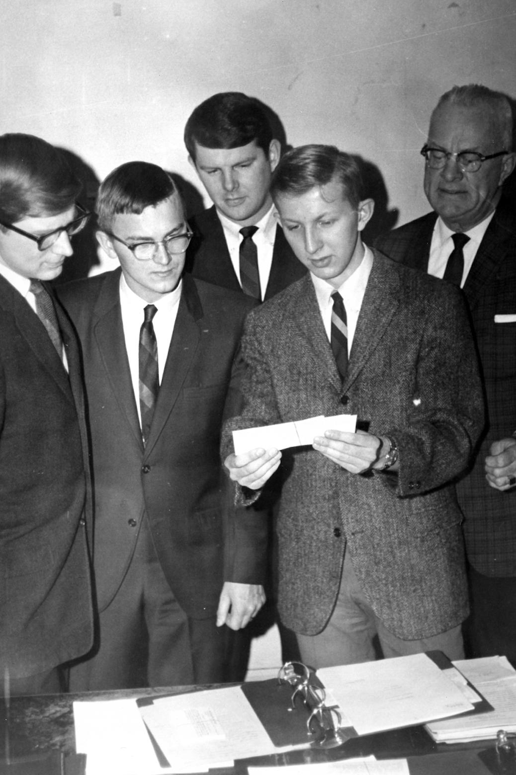 Johnson and his students looking at notecards