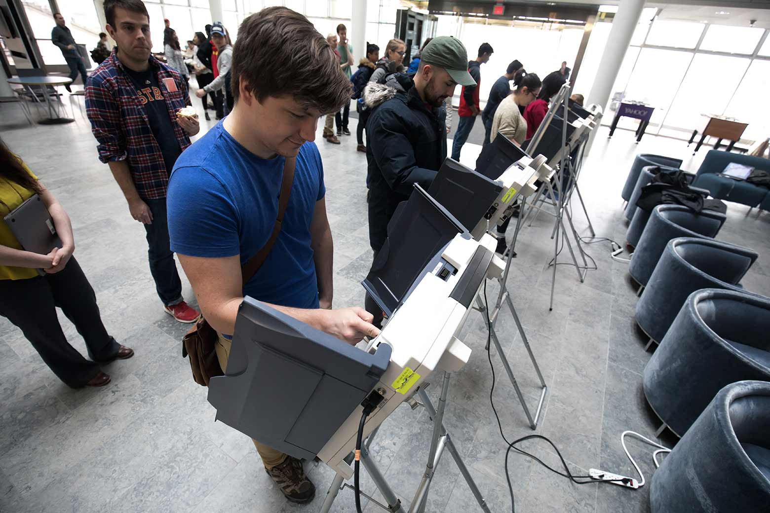 student voting at voting machine